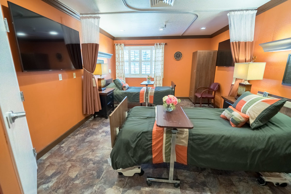 Orange Room: Winery and vineyard inspired wine cellar room at Eden Valley Care Center